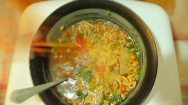 time lapse: person eating instant noodles - ramen noodles stock videos & royalty-free footage