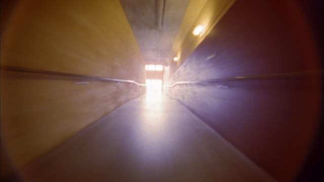 time lapse point of view through corridors of warehouse / office building - corridoio caratteristica di una costruzione video stock e b–roll