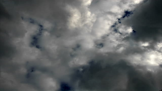 time lapse rain clouds roil in a deep blue sky. - digital enhancement stock videos & royalty-free footage