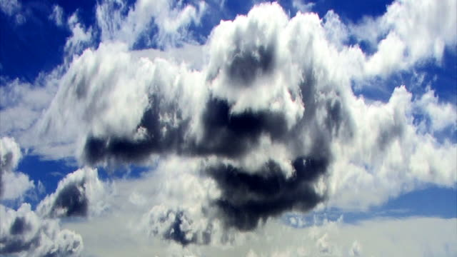 time lapse rain clouds roil in a deep blue sky. - digital enhancement stock videos and b-roll footage