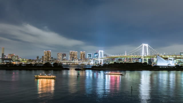 time lapse - rainbow bridge and tokyo tower at night - tokyo bay stock videos & royalty-free footage