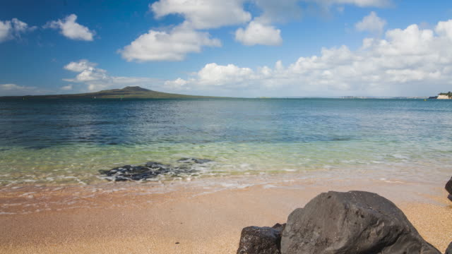 Time Lapse Rangitoto Island, from Takapuna Beach, Auckland, New Zealand.