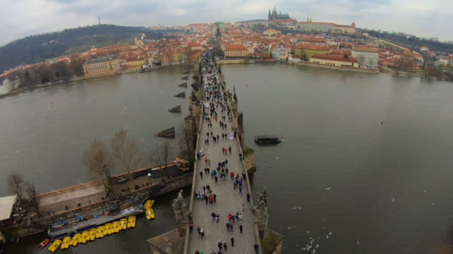 time lapse recorded from above the charles bridge of prague with cityscape and crowd of tourist people walking visiting the city in winter with cloudy day. - traditionally czech stock videos & royalty-free footage