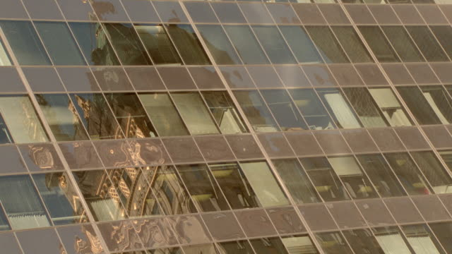 time lapse reflections of ornate building + sunlight in building windows / day to night / nyc - 1997 stock videos and b-roll footage