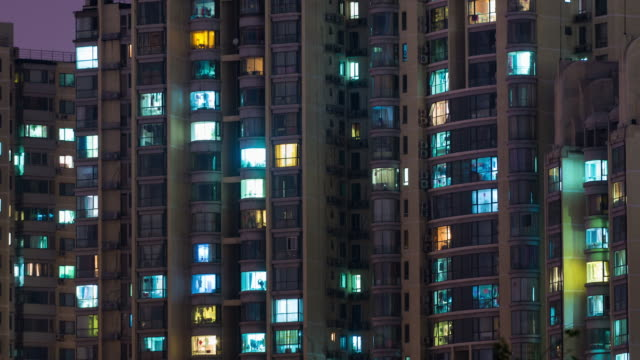 time lapse- residential area at night, beijing (panning) - appartamento video stock e b–roll