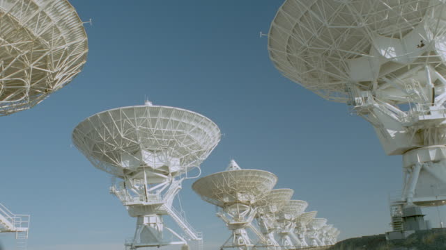 time lapse rows of vla (very large array) radio telescope dishes moving / new mexico - broadcasting stock videos & royalty-free footage
