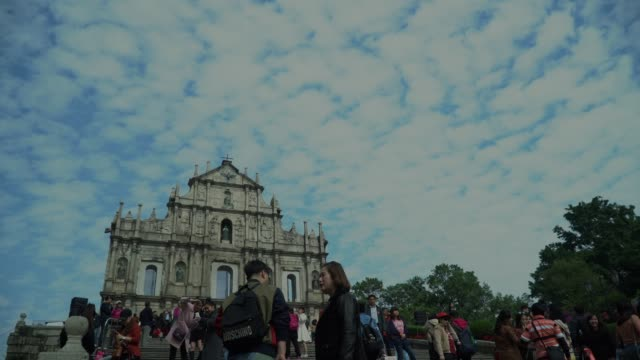time lapse ruins of st.paul's church in macau city - macao flag stock videos and b-roll footage