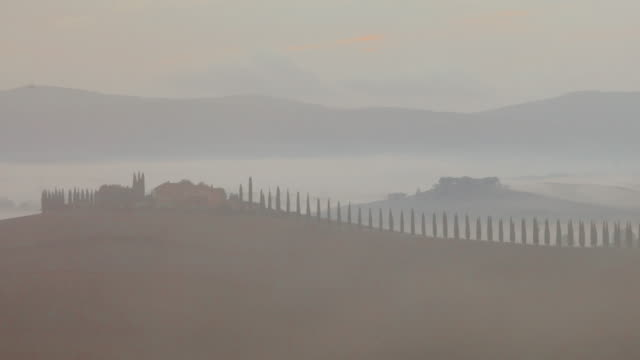 time lapse: rural countryside landscape at sunrise in tuscany region of italy. - villa stock videos & royalty-free footage