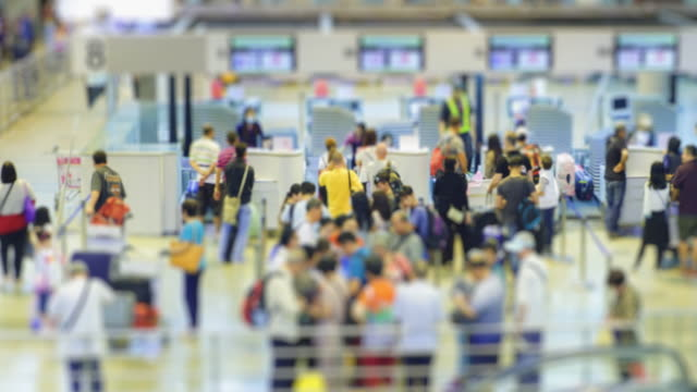 4K time lapse rush hour the crowd checking or buy flight ticket at airport