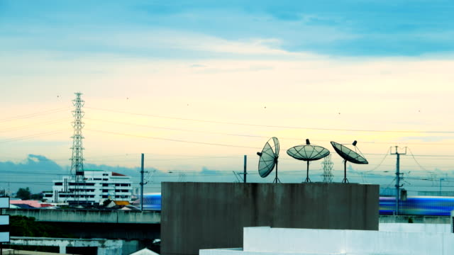 4k time lapse : satellite dishes on rooftop in bangkok city - atmosphere filter stock videos & royalty-free footage