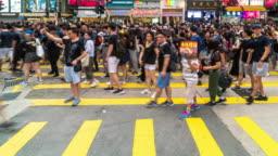 4K Time lapse scene of crowd Unrecognizable Protester walking around Tsim Sha Tsui area, Hong Kong