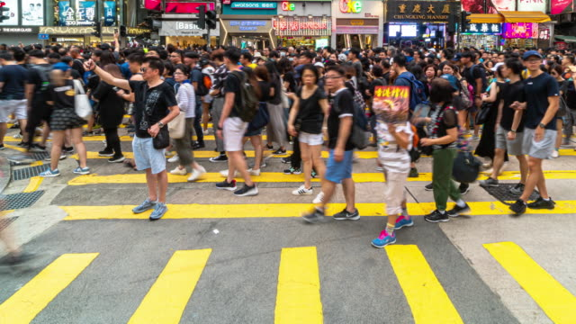 4k time lapse scene of crowd unrecognizable protester walking around tsim sha tsui area, hong kong - protest stock videos & royalty-free footage