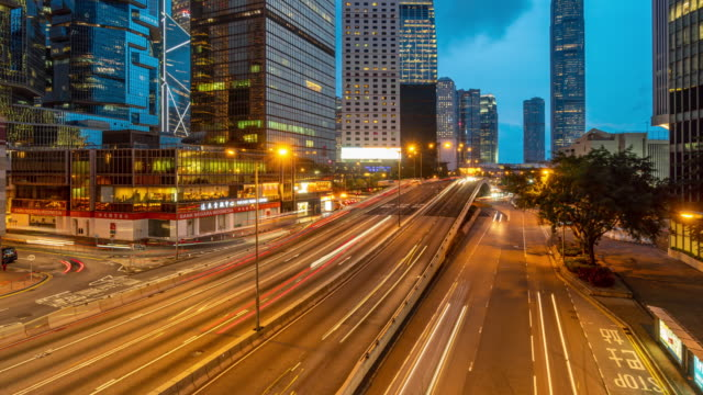 4k time lapse scene of hong kong cityscape at the day to night time - day to night stock videos & royalty-free footage