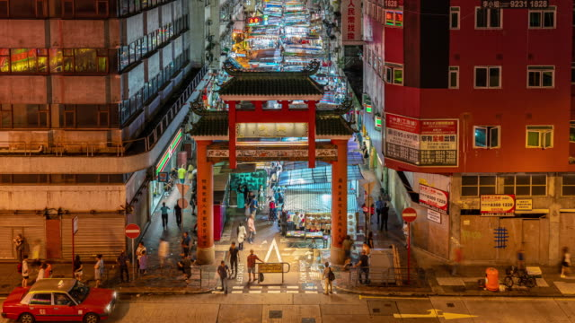 4K Time lapse scene of Temple Street night market, Yau Ma Tei Station, Hong Kong