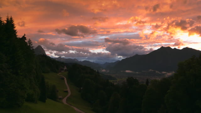 time lapse. scenic view over wamberg mountain village and waxenstein mountain in the background, near sunset. - garmisch partenkirchen stock videos and b-roll footage