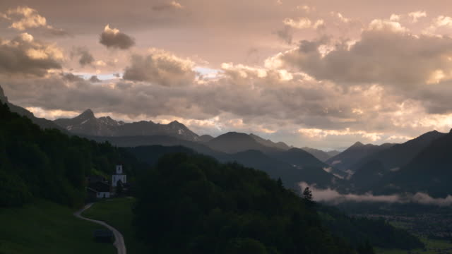 time lapse. scenic view over wamberg mountain village and waxenstein mountain in the background, near sunset. - werdenfelser land stock videos and b-roll footage