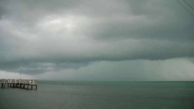 time lapse sequence of a thunderstorms ominous dark clouds approaching marathon fl in the middle florida keys - scott mcpartland bildbanksvideor och videomaterial från bakom kulisserna