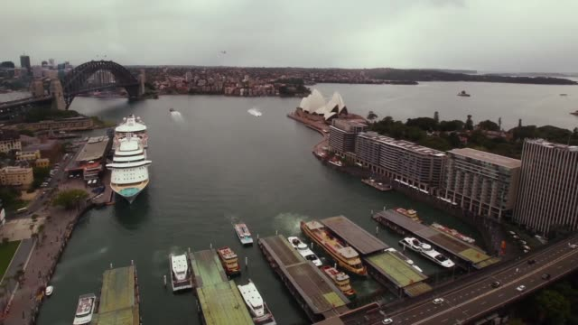 time lapse sequence of sydney harbour from 6am to 9pm high angle view showing boats moving around harbour clouds moving across the sky sydney opera... - bennelong point stock videos and b-roll footage