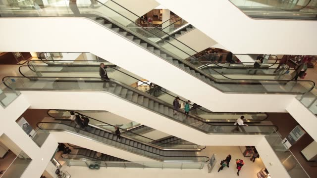 time lapse sequence showing customers travelling on escalators inside a john lewis plc department store in london uk on monday sept 16 2013 time... - plc stock videos & royalty-free footage