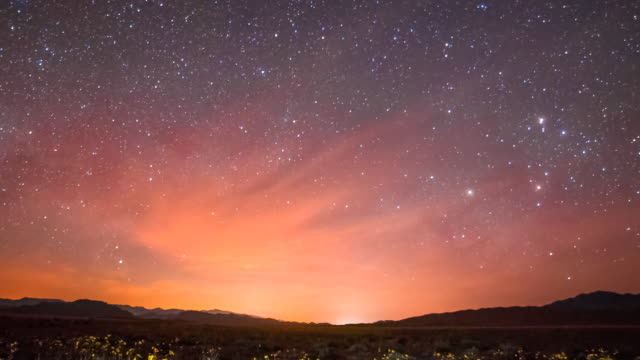 time lapse sequence showing stars moving over a road in death valley, california. - constellation stock videos & royalty-free footage