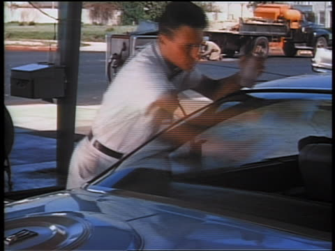 1959 time lapse service station attendant cleaning car windshield / educational - 1959 stock videos & royalty-free footage
