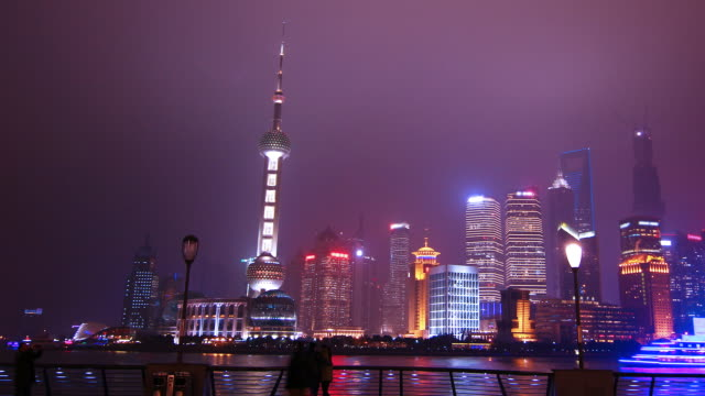 time lapse - shanghai skyline at night (panning) - jin mao tower stock videos & royalty-free footage