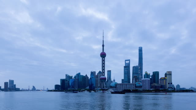 time lapse shanghai skyline ,night to day/ shanghai, china - jin mao tower stock videos & royalty-free footage