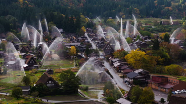 4k time lapse shirakawago village,the water festival with mountain and house gifu prefecture, japan - fire hose stock videos & royalty-free footage
