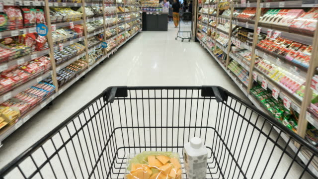 time lapse shopping cart in supermarket - shopping trolley stock videos & royalty-free footage