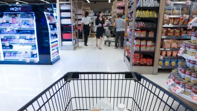 time lapse shopping cart view in a supermarket - merchandise stock videos & royalty-free footage