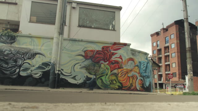 time lapse shot across street art on a wall in bogota. - bogota stock videos & royalty-free footage