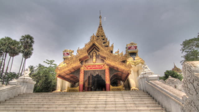 Time lapse shot across the entrance to the Shwedagon Pagoda in Yangon.