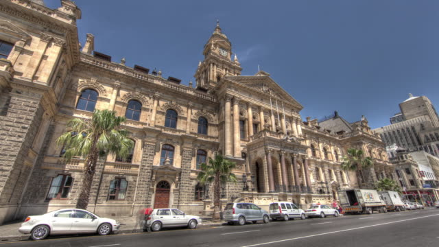 time lapse shot across the exterior of cape town's city hall. - facade stock videos & royalty-free footage