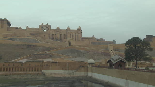 time lapse shot amber fort jaipur rajasthan india - fortress stock videos & royalty-free footage