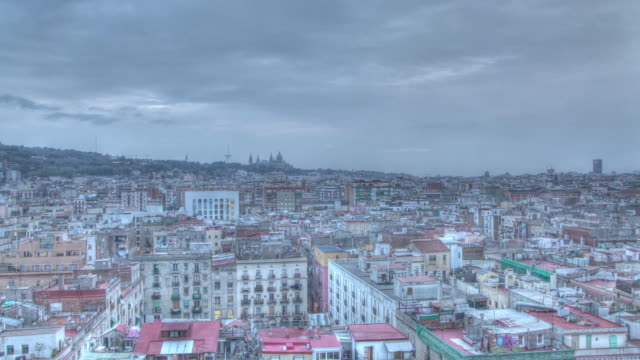 time lapse shot from day to dusk over the city of barcelona. - day to dusk stock videos & royalty-free footage