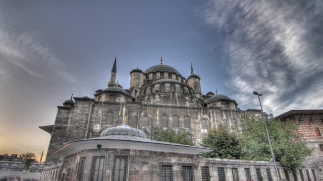 time lapse shot from day to night across the exterior of the yeni cami mosque in istanbul. - yeni cami mosque stock videos and b-roll footage