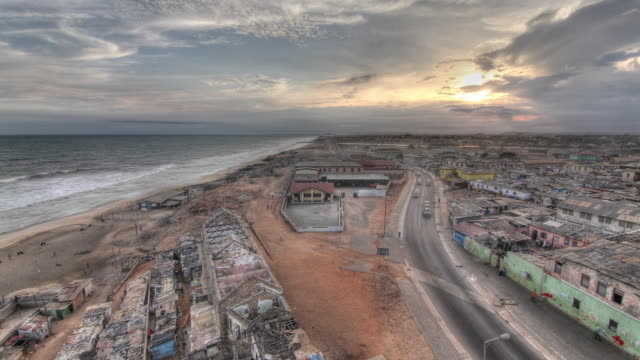 time lapse shot from day to night over a beach in accra. - capital cities stock videos & royalty-free footage