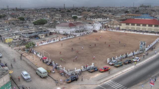 time lapse shot from day to night over a football pitch in the city of accra. - ghana stock videos and b-roll footage