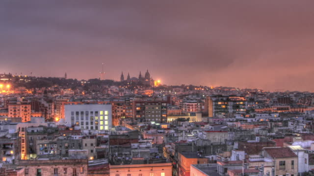 Time lapse shot from dusk to night over the city of Barcelona.