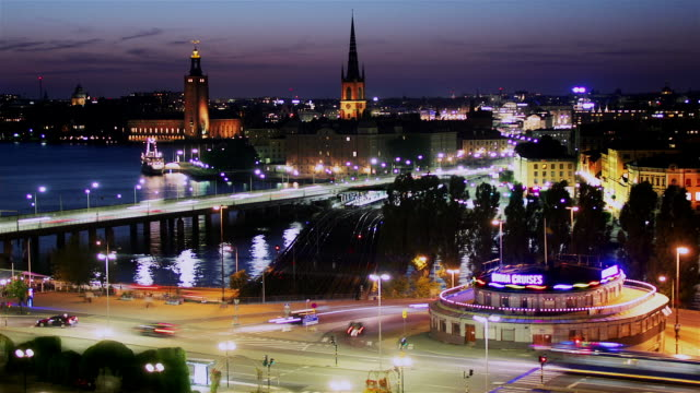 time lapse shot from sodermalm of gamla stan and traffic passing over bridge at night / stockholm, sweden - sweden stock videos & royalty-free footage