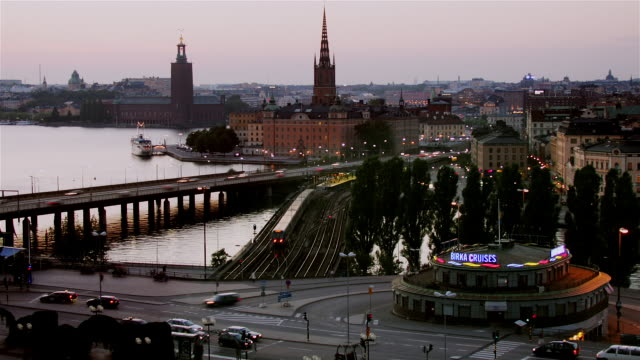 time lapse shot from sodermalm of gamla stan and traffic passing over bridge as dusk turns to night / stockholm, sweden - famous place stock videos & royalty-free footage