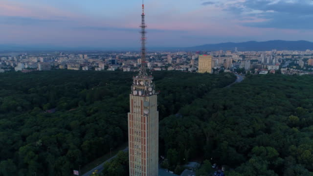 time lapse shot of a drone flying around orbiting radio tower at sunset - radio broadcasting stock videos and b-roll footage