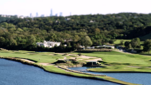 Time lapse shot of a golf course - miniature effect