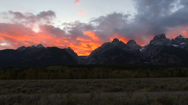 WS HD time lapse shot of a Grand Teton sunset