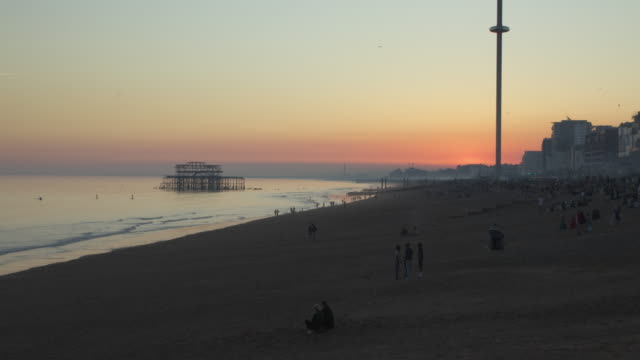 time lapse shot of a sunset over brighton beach facing the west pier and i360 observation tower. - solar flare stock videos & royalty-free footage