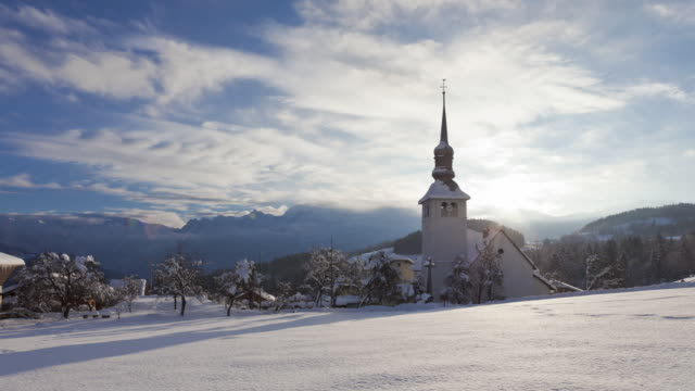 Time Lapse shot of baroque church of Cordon with Mont Blanc massif in the background
