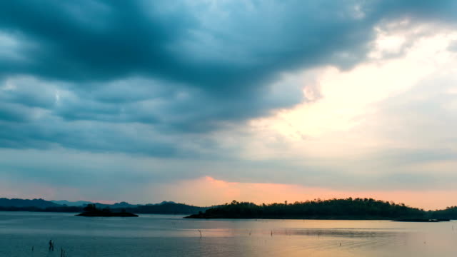 time lapse shot of beautiful lake and small island with storm cloud - tree trunk stock videos & royalty-free footage