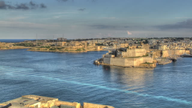 time lapse shot of boats moving valletta's grand harbour. - high dynamic range imaging stock videos and b-roll footage