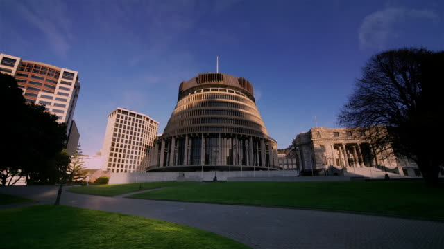 time lapse shot of bowen house, the beehive, and parliament house / wellington, new zealand - parliament building stock videos & royalty-free footage