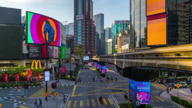 time lapse shot of busy traffic in financial district at kuala lumpur's city. - kuala lumpur stock videos & royalty-free footage